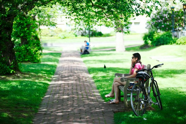 Woman with bicycle in the Quad